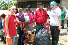 Students distribute gifts to the villagers of La Ca�ada
