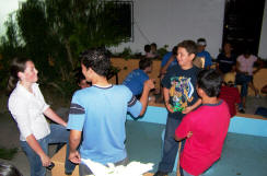 Amanda Cronin visits with the teens of Esquias in the compound