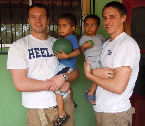 Zach Maxey & Pete Fitzsimmons hold 2 little boys at the malnutrition center in Sulaco