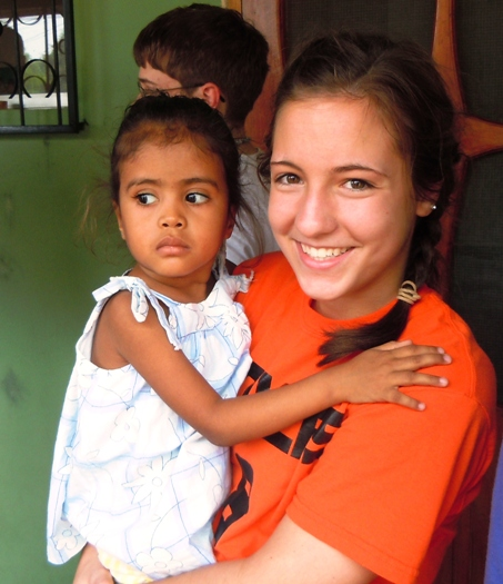 Becca Vonnahme holds a little girl at the malnutrition center in Sulaco