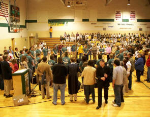 team receives blessing at send-off ceremony