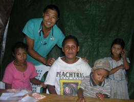 Dr. David Goo poses with some patients