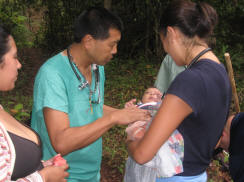 Dr. David Goo & Dr. Jessica Doyle examine baby on the mountain trail
