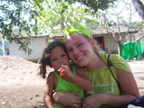 Kara Krienert with a young girl from the orphanage